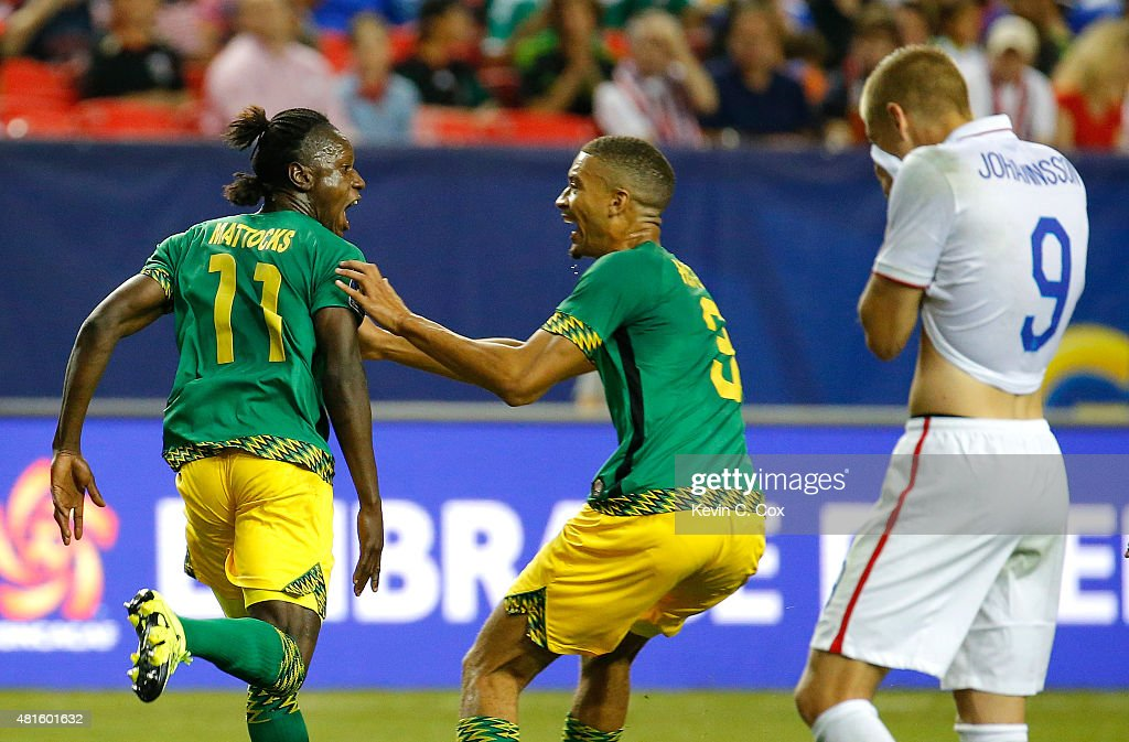 Darren Mattocks of Jamaica celebrates scoring the opening goal against the United States of America with Michael Hector during the 2015 CONCACAF Golf...