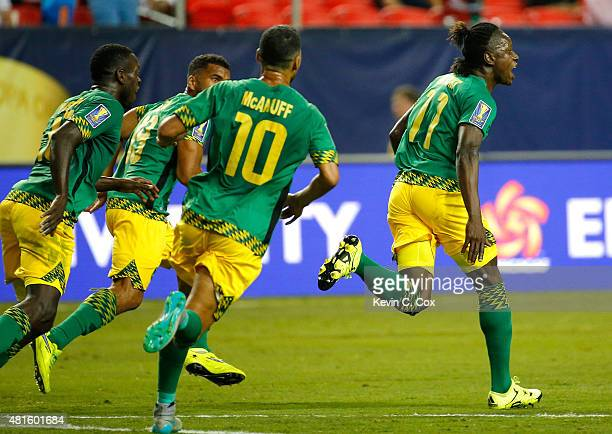 Darren Mattocks of Jamaica celebrates scoring the opening goal against the United States of America during the 2015 CONCACAF Golf Cup Semifinal match...