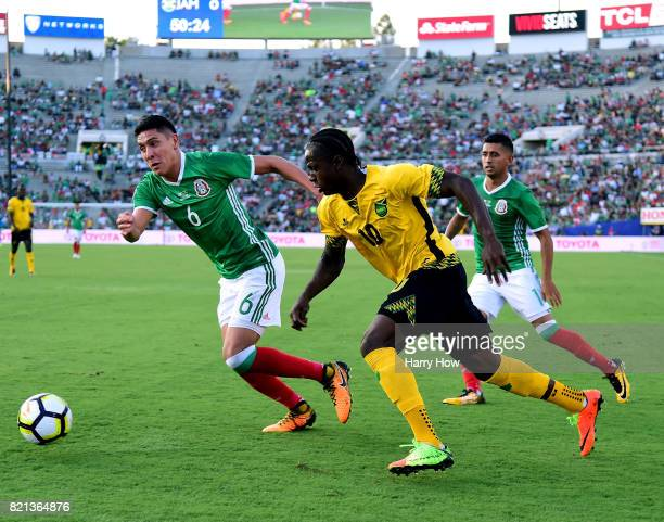 Darren Mattocks of Jamaica works his way past Edson Alvarez and Elias Hernandez of Mexico during a 10 Jamaican win in the CONCACAF 2017 semifinal at...