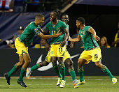 Darren Mattocks of the Jamaica celebrates with teammates after his first half goal during the 2015 CONCACAF Gold Cup semifinal match against the...