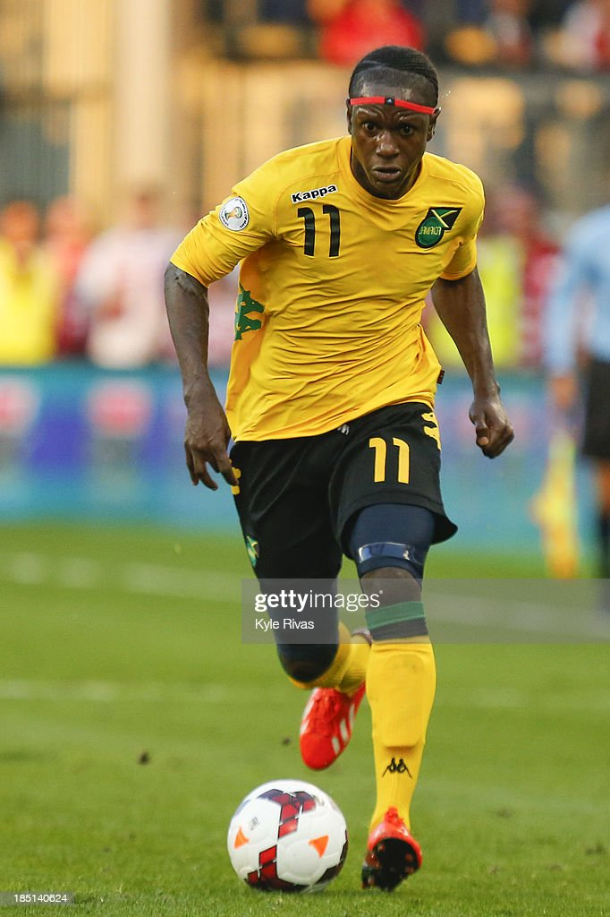 Darren Mattocks of the Jamaica moves down the field against the US Men's National Soccer Team at Sporting Park on October 11 2013 in Kansas City...