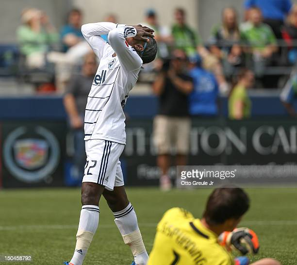 Darren Mattocks of the Vancouver Whitecaps reacts after missing a goal against goalkeeper Michael Gspurning of the Seattle Sounders FC at CenturyLink...