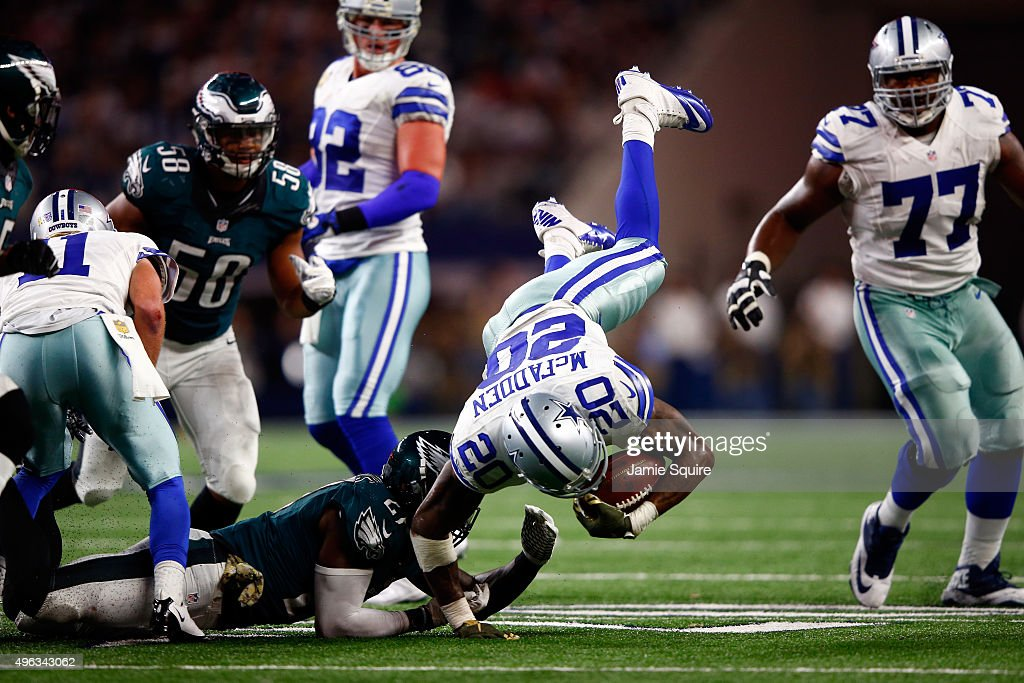 Darren McFadden of the Dallas Cowboys is tripped up by Malcolm Jenkins of the Philadelphia Eagles in the second half at ATT Stadium on November 8...