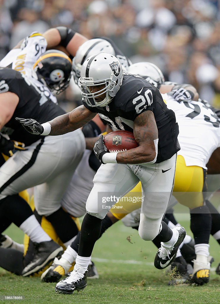 <a gi-track='captionPersonalityLinkClicked' href=/galleries/search?phrase=Darren+McFadden&family=editorial&specificpeople=2146070 ng-click='$event.stopPropagation()'>Darren McFadden</a> #20 of the Oakland Raiders in action against the Pittsburgh Steelers at O.co Coliseum on October 27, 2013 in Oakland, California.