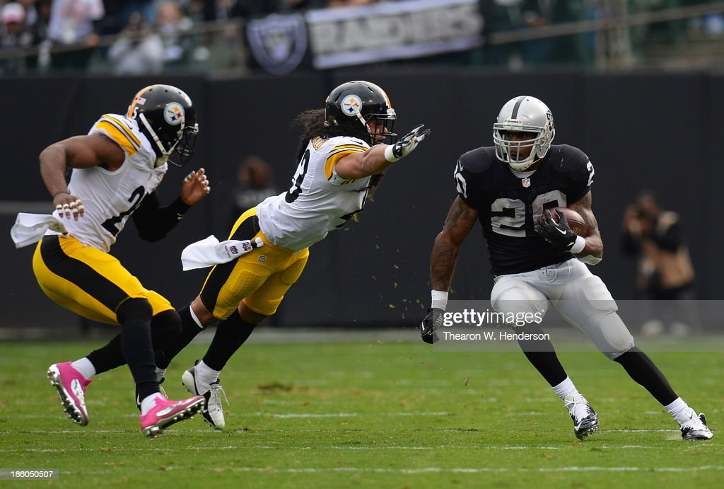 <a gi-track='captionPersonalityLinkClicked' href=/galleries/search?phrase=Darren+McFadden&family=editorial&specificpeople=2146070 ng-click='$event.stopPropagation()'>Darren McFadden</a> #20 of the Oakland Raiders rushes for a nineteen yard gain, avoiding the tackle of <a gi-track='captionPersonalityLinkClicked' href=/galleries/search?phrase=Troy+Polamalu&family=editorial&specificpeople=206488 ng-click='$event.stopPropagation()'>Troy Polamalu</a> #43 of the Pittsburgh Steelers during the second quarter at O.co Coliseum on October 27, 2013 in Oakland, California.