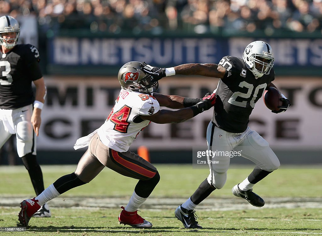 <a gi-track='captionPersonalityLinkClicked' href=/galleries/search?phrase=Darren+McFadden&family=editorial&specificpeople=2146070 ng-click='$event.stopPropagation()'>Darren McFadden</a> #20 of the Oakland Raiders tries to get away from Lavonte David #54 of the Tampa Bay Buccaneers at O.co Coliseum on November 4, 2012 in Oakland, California.