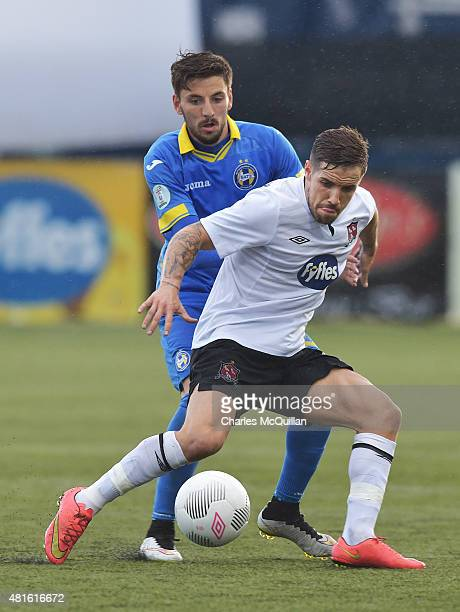 Darren Meenan of Dundalk and Filip Mladenovic of BATE Borisov during the Champions League 2nd round qualifying game at Oriel Park on July 22 2015 in...