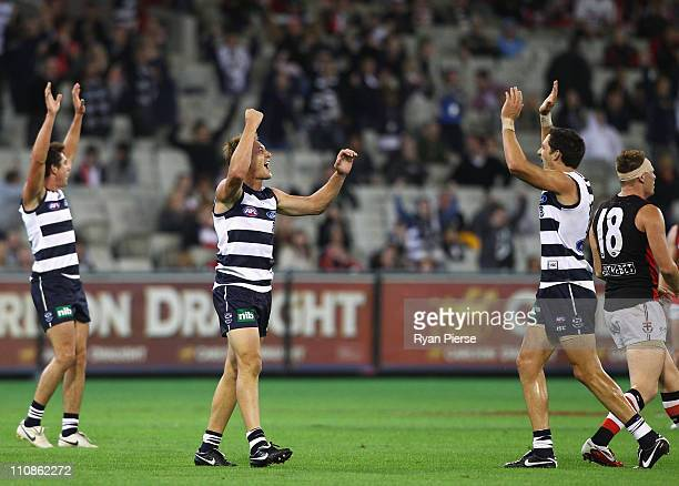 Darren Milburn and Harry Talyor of the Cats celebrate on the final siren during the round one AFL match between the Geelong Cats and the St Kilda...
