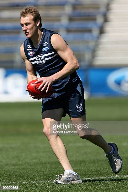Darren Milburn of the Cats runs with the ball during a Geelong Cats AFL training session at Skilled Stadium September 21 2009 in Melbourne Australia