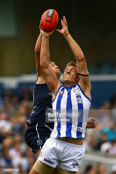 Darren Milburn of the Cats spoils from behind during the Pool Six NAB Cup round one AFL match between the Geelong Cats and the North Melbourne...