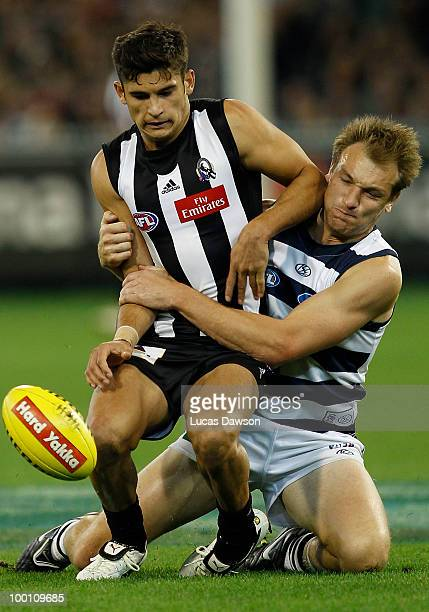 Darren Milburn of the Cats tackles Sharrod Wellingham of the Magpies during the round nine AFL match between the Collingwood Magpies and the Geelong...