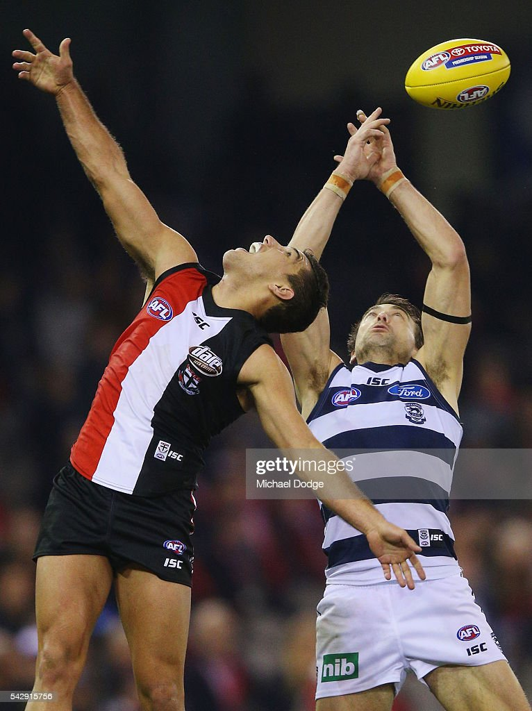 Darren Minchington of the Saints (L) and Corey Enright of the Cats compete for the ball during the round 14 AFL match between the St Kilda Saints and the Geelong Cats at Etihad Stadium on June 25, 2016 in Melbourne, Australia.