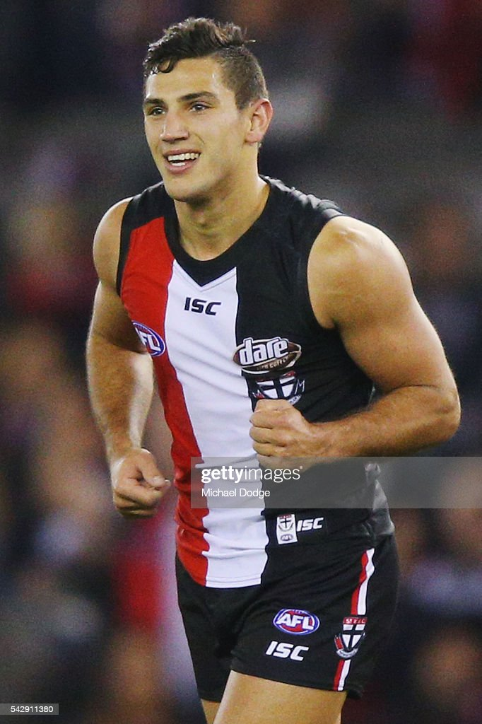 Darren Minchington of the Saints celebrates a goal during the round 14 AFL match between the St Kilda Saints and the Geelong Cats at Etihad Stadium on June 25, 2016 in Melbourne, Australia.