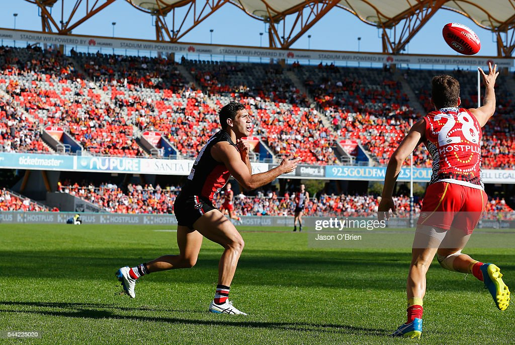 Darren Minchington of the saints gets a handball away during the round 15 AFL match between the Gold Coast Suns and the St Kilda Saints at Metricon Stadium on July 2, 2016 in Gold Coast, Australia.