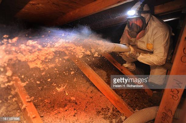 Darren Montoya blows insulation or cellulose which is recycled newspapers into the attic space of a house in Longmont He works for Longs Peak Energy...