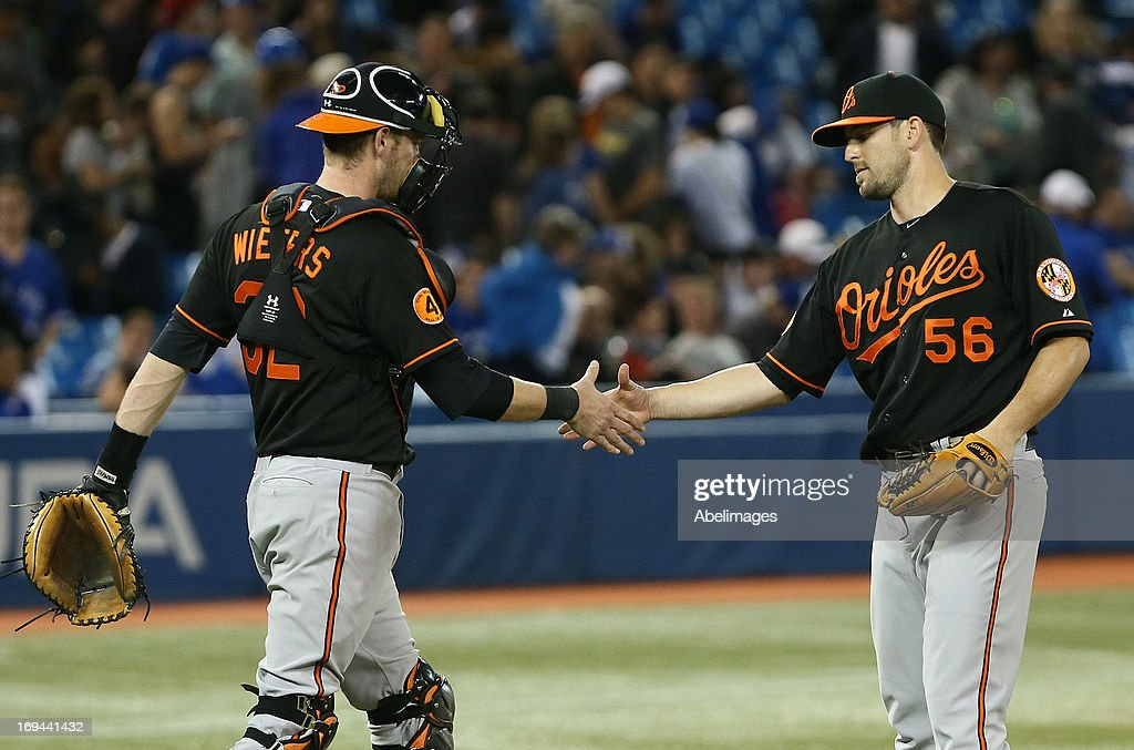 Darren O'Day #56 and Matt Wieters #32 of the Baltimore Orioles celebrate the win against the Toronto Blue Jays during MLB action at the Rogers Centre May 24, 2013 in Toronto, Ontario, Canada.