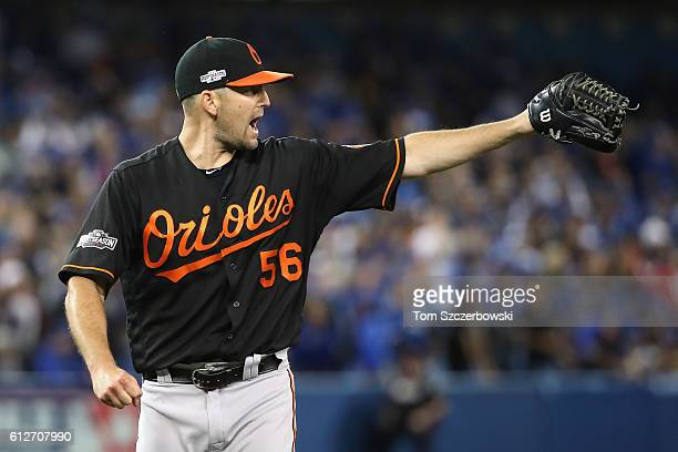 Darren O'Day of the Baltimore Orioles celebrates after the final out in the tenth inning against the Toronto Blue Jays during the American League...