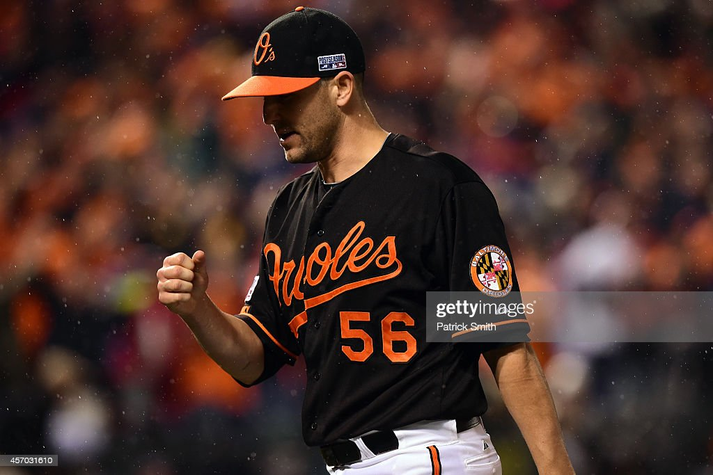 Darren O'Day of the Baltimore Orioles celebrates closing out the ninth inning against the Kansas City Royals during Game One of the American League...