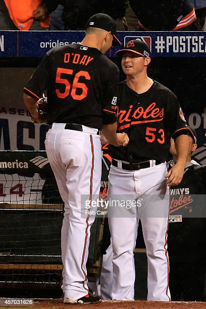 Darren O'Day of the Baltimore Orioles celebrates with teammate Zach Britton after closing out the ninth inning against the Kansas City Royals during...