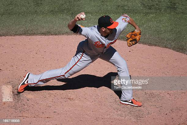 Darren O'Day of the Baltimore Orioles delivers a pitch during MLB game action against the Toronto Blue Jays on May 25 2013 at Rogers Centre in...