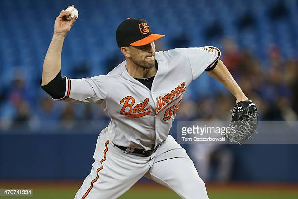 Darren O'Day of the Baltimore Orioles delivers a pitch in the eighth inning during MLB game action against the Toronto Blue Jays on April 22 2015 at...