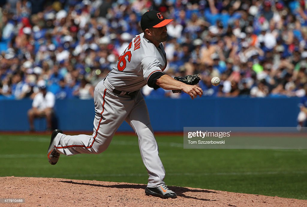 Darren O'Day of the Baltimore Orioles delivers a pitch in the eighth inning during MLB game action against the Toronto Blue Jays on June 20 2015 at...