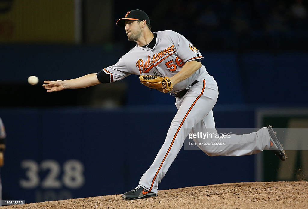 Darren O'Day of the Baltimore Orioles delivers a pitch in the eighth inning during MLB game action against the Toronto Blue Jays on April 23 2014 at...