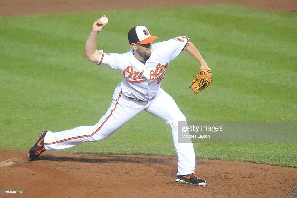Darren O'Day of the Baltimore Orioles pitches during a baseball game against the Boston Red Sox on June 11 2014 at Oriole Park at Camden Yards in...