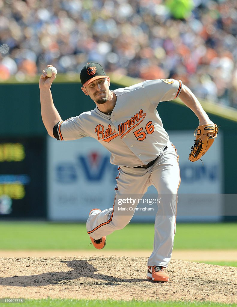 Darren O'Day of the Baltimore Orioles pitches during the game against the Detroit Tigers at Comerica Park on August 19 2012 in Detroit Michigan The...