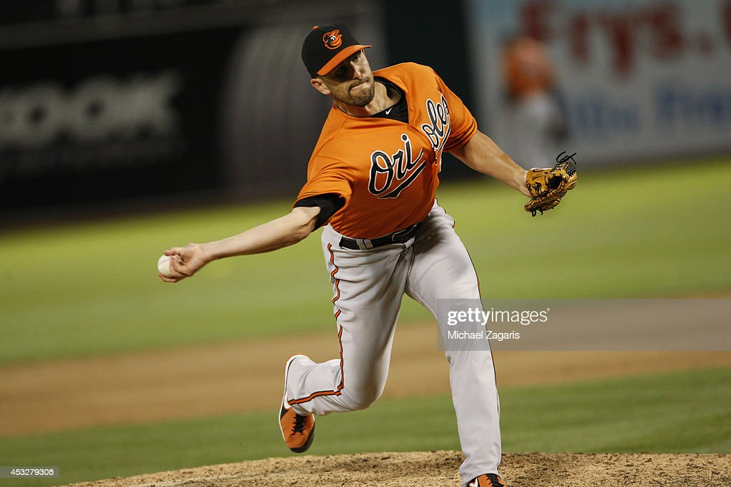 Darren O'Day of the Baltimore Orioles pitches during the game against the Oakland Athletics at Oco Coliseum on July 19 2014 in Oakland California The...