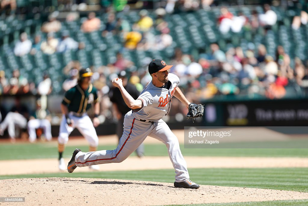 Darren O'Day of the Baltimore Orioles pitches during the game against the Oakland Athletics at Oco Coliseum on August 5 2015 in Oakland California...