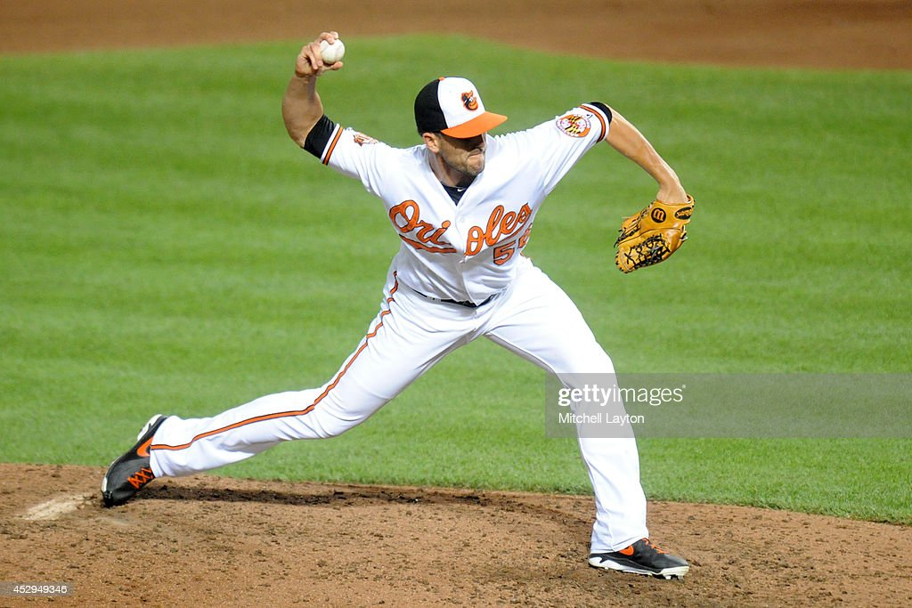 Darren O'Day #56 of the Baltimore Orioles pitches in the eighth inning during a baseball game against the Los Angeles Angels of Anaheim on July 30, 2014 at Oriole Park at Camden Yards in Baltimore, Maryland. The Orioles won 4-3.
