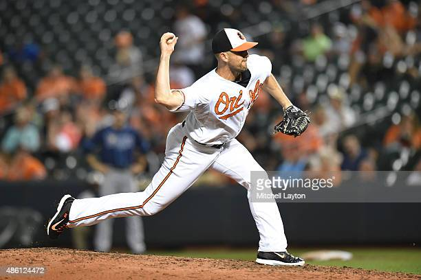 Darren O'Day of the Baltimore Orioles pitches in the ninth inning during a baseball game against the Tampa Bay Rays at Oriole Park at Camden Yards on...