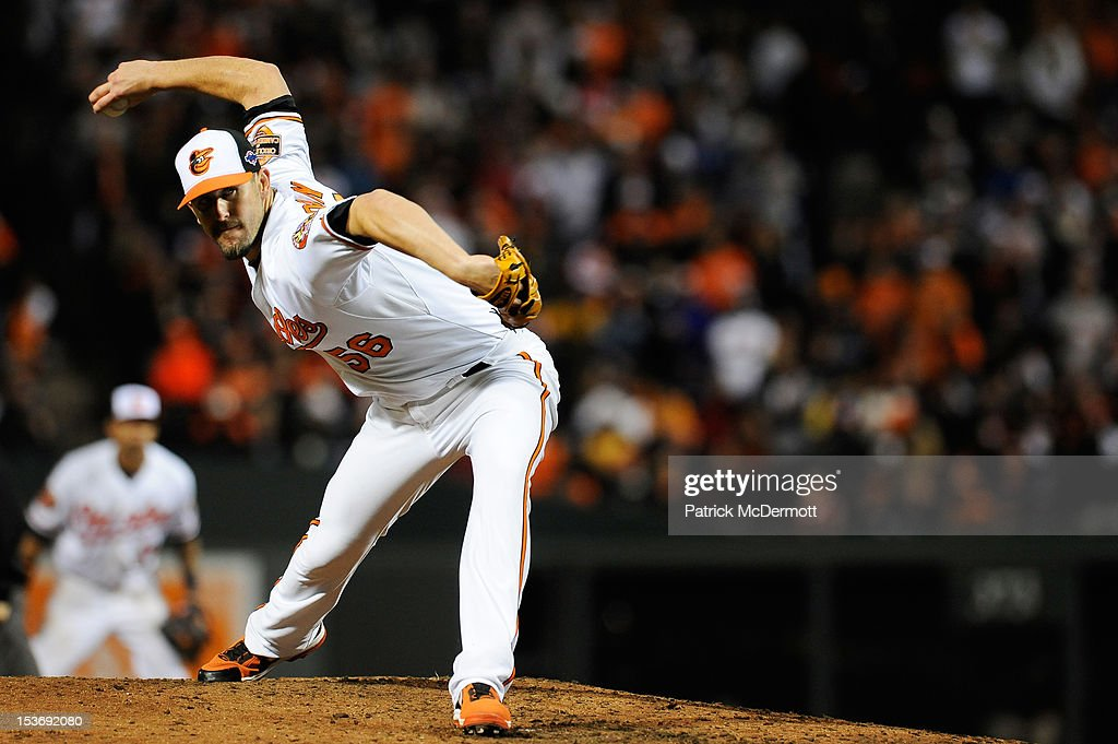 Darren O'Day of the Baltimore Orioles pitches in the top of the seventh inning after relieving WeiYin Chen during Game Two of the American League...