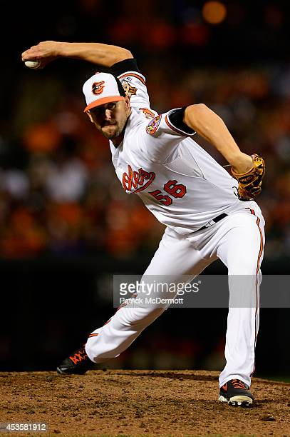 Darren O'Day of the Baltimore Orioles throws a pitch in the eighth inning against the New York Yankees during a baseball game at Oriole Park at...