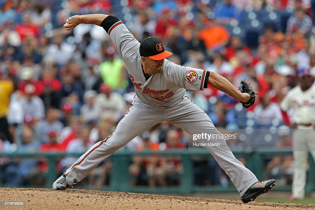 Darren O'Day of the Baltimore Orioles throws a pitch in the seventh inning during a game against the Philadelphia Phillies at Citizens Bank Park on...