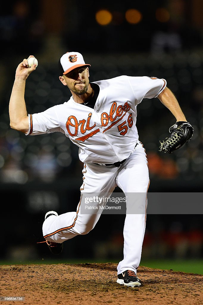 Darren O'Day of the Baltimore Orioles throws a pitch to a Tampa Bay Rays batter in the ninth inning during a baseball game at Oriole Park at Camden...