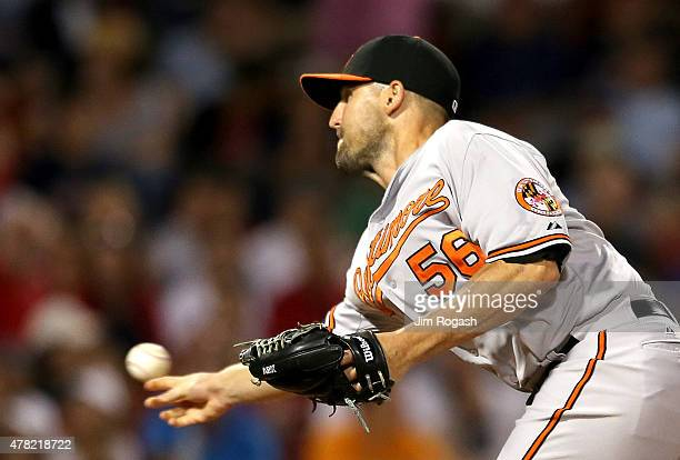 Darren O'Day of the Baltimore Orioles throws in the eight inning against the Boston Red Sox at Fenway Park on June 23 2015 in Boston Massachusetts