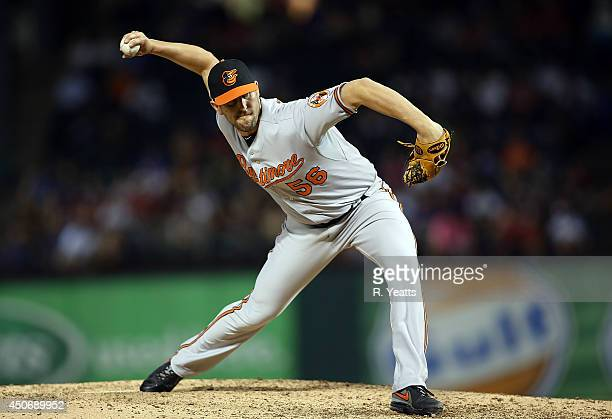 Darren O'Day of the Baltimore Orioles throws in the seventh inning against the Texas Rangers at Globe Life Park in Arlington on June 4 2014 in...