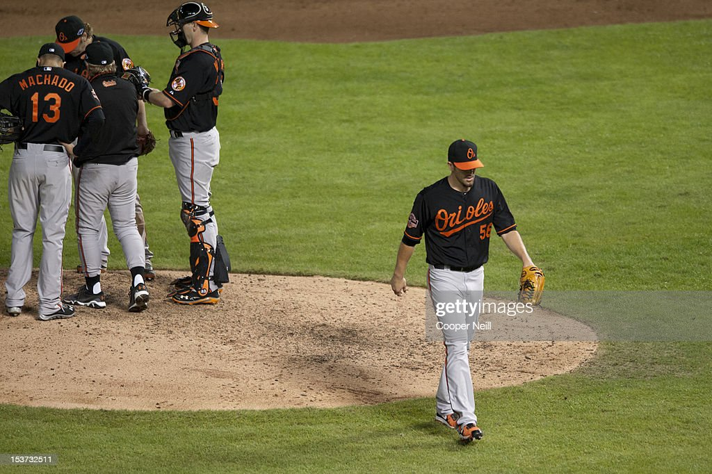 Darren O'Day of the Baltimore Orioles walks to the dugout after being relieved during the American League Wild Card game against the Texas Rangers on...