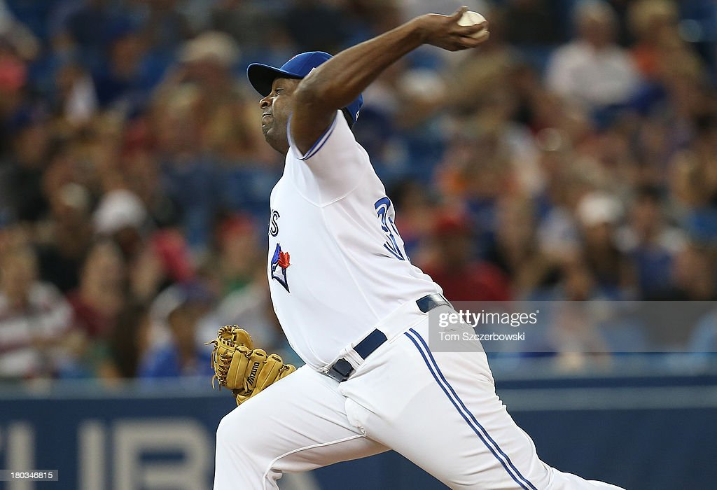 <a gi-track='captionPersonalityLinkClicked' href=/galleries/search?phrase=Darren+Oliver&family=editorial&specificpeople=220688 ng-click='$event.stopPropagation()'>Darren Oliver</a> #38 of the Toronto Blue Jays delivers a pitch in the ninth inning during MLB game action against the Los Angeles Angels of Anaheim on September 11, 2013 at Rogers Centre in Toronto, Ontario, Canada.