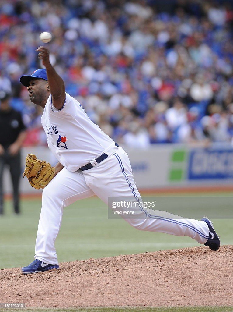 <a gi-track='captionPersonalityLinkClicked' href=/galleries/search?phrase=Darren+Oliver&family=editorial&specificpeople=220688 ng-click='$event.stopPropagation()'>Darren Oliver</a> #38 of the Toronto Blue Jays delivers his last pitch during the seventh inning of MLB game action against the Tampa Bay Rays September 29, 2013 at Rogers Centre in Toronto, Ontario, Canada.