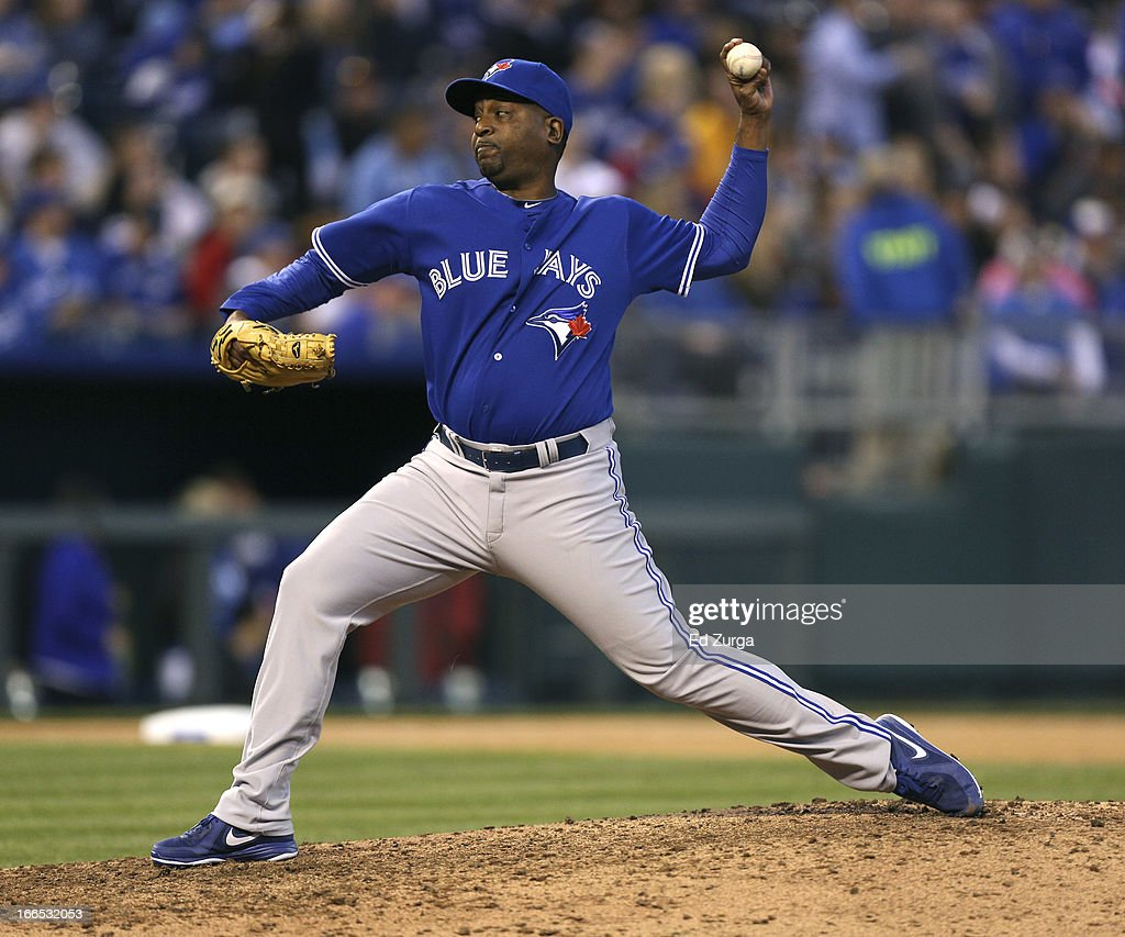<a gi-track='captionPersonalityLinkClicked' href=/galleries/search?phrase=Darren+Oliver&family=editorial&specificpeople=220688 ng-click='$event.stopPropagation()'>Darren Oliver</a> #38 of the Toronto Blue Jays pitches against the Kansas City Royals in the seventh inning at Kauffman Stadium April 13, 2013 in Kansas City, Missouri.