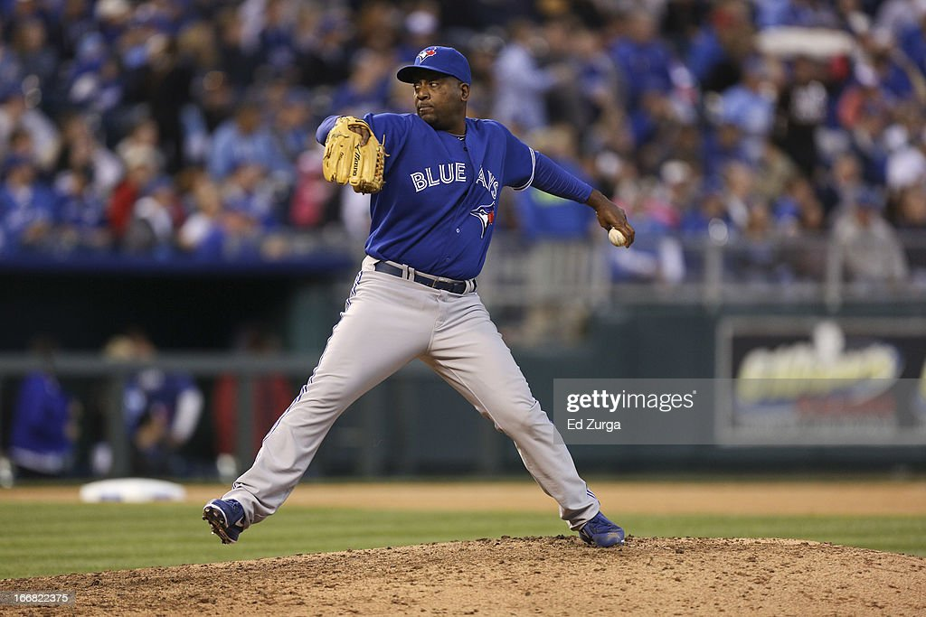 <a gi-track='captionPersonalityLinkClicked' href=/galleries/search?phrase=Darren+Oliver&family=editorial&specificpeople=220688 ng-click='$event.stopPropagation()'>Darren Oliver</a> #38 of the Toronto Blue Jays pitches against the Kansas City Royals at Kauffman Stadium April 13, 2013 in Kansas City, Missouri.