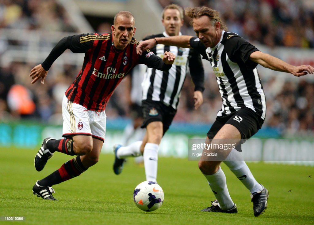 Darren Peacock (R) of Newcastle United vies for the ball with Paolo Di Canio (L) of AC Milan Glorie during Steve Harper's testimonial match between Newcastle United and AC Milan Glorie at St James' Park on September 11, 2013 in Newcastle upon Tyne, England.