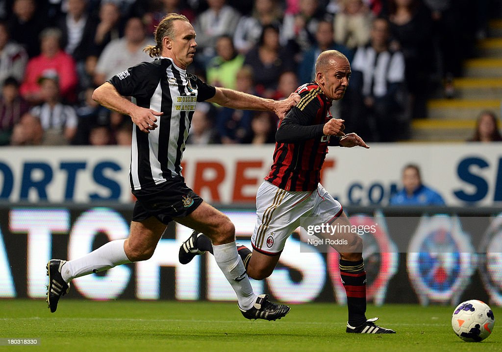 Darren Peacock (L) of Newcastle United vies for the ball with Paolo Di Canio (R) of AC Milan during Steve Harper's testimonial match between Newcastle United and AC Milan Glorie at St James' Park on September 11, 2013 in Newcastle upon Tyne, England.