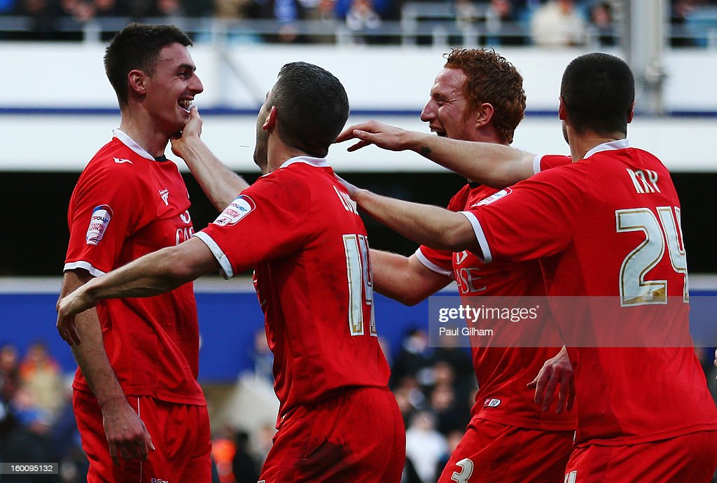 Darren Potter (L) of Milton Keynes Dons celebrates with team mates after scoring his sides fourth goal during the FA Cup with Budweiser Fourth Round match between Queens Park Rangers and Milton Keynes Dons at Loftus Road on January 26, 2013 in London, England.