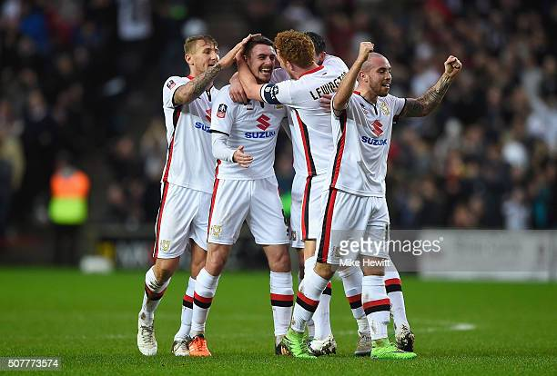 Darren Potter of MK Dons celebrates scoring his team's opening goal with team mates during the Emirates FA Cup Fourth Round match between Milton...