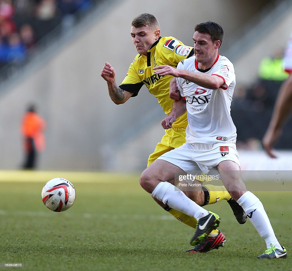 Darren Potter of MK Dons contests the ball with Max Power of Tranmere Rovers during the npower League One match between MK Dons and Tranmere Rovers at Stadium MK on March 16, 2013 in Milton Keynes, England.