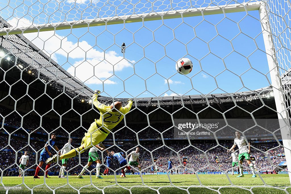 Darren Randolph of Republic of Ireland dives in vain as Antoine Griezmann (C) of France scores his team's second goal during the UEFA EURO 2016 round of 16 match between France and Republic of Ireland at Stade des Lumieres on June 26, 2016 in Lyon, France.